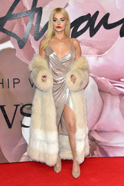 Bebe Rexha layered a two-tone fur coat over her frock for added glamour.