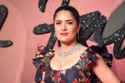 Salma Hayek complemented her low-cut dress with a statement-making diamond filigree necklace.