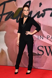 Kate Beckinsale was sleek and stylish in a black Ralph Lauren pantsuit at the Fashion Awards 2016.