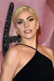 Lady Gaga kept it classic with a pair of diamond studs at the Fashion Awards 2016.
