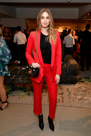 Whitney Port opted for a red pantsuit and a black shirt when she attended the Fashion Awards 2017 nominees reception.