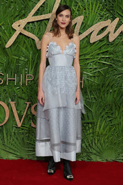 Alexa Chung styled her dress with a pair of crystal-adorned boots by Roger Vivier.