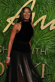 Naomi Campbell styled her gown with a silver and black cuff bracelet for the Fashion Awards 2017.