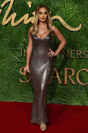 Rita Ora made eyes pop in a slinky gunmetal chainmail gown by Versace at the Fashion Awards 2017.