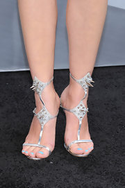 Marion Cotillard chose silver studded heels for a cool and modern look at 'The Dark Knight Rises' premiere.