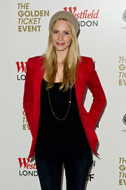 Poppy dons a bold red blazer with her black ensemble for the Fashion for Relief event.