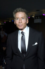 Calvin Klein paired his basic black suit with a choral colored tie.
