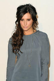 Ashley showed off her long curls which she pinned half up while letting her bangs flow around her face.