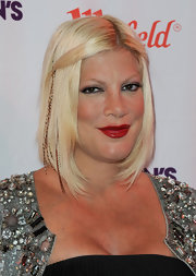 The trend continues as Tori Spelling rocks some seriously red lips at Fashion's Night Out in Topanga, CA. To get Tori's look, try Covergirl LipPerfection Lipcolor in Hot, a warm, decadent shade of crimson.