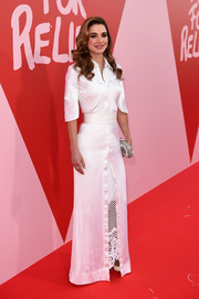 Queen Rania looked perfectly polished in a white maxi shirtdress by Givenchy Couture on the Fashion for Relief red carpet.