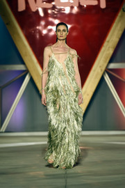 Erin O'Connor sashayed down the Fashion for Relief runway wearing a fully fringed metallic-green gown.