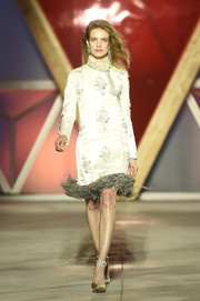 Natalia Vodianova was all about refined elegance at the Fashion for Relief runway show in a champagne satin cocktail dress with clustered beading and a feathered hem.