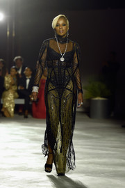 Mary J. Blige joined the Fashion for Relief runway show looking sultry in a sheer, embellished black gown by Reem Acra.