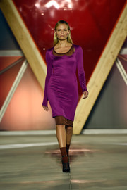 Natasha Poly donned a figure-hugging dress, in a vibrant purple hue with a brown underlay, for the Fashion for Relief runway show.