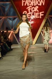 We couldn't take our eyes off Heidi Klum when she walked the Fashion for Relief runway wearing this 'Canned Candies' tee and sheer skirt combo.