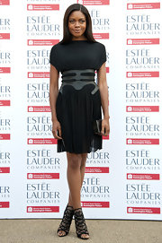 Naomie Harris showed off her tiny waist with this black dress with a cinched leather waist detail.