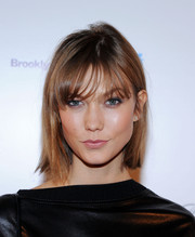 Karlie Kloss kept it simple with this short straight cut with wispy bangs when she attended the Fashion World of Jean Paul Gaultier reception.
