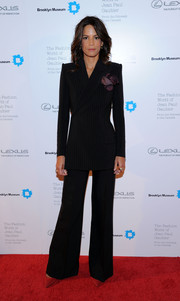 Veronica Webb was androgynous-chic in a black pinstripe pantsuit feature flared trousers when she attended the Fashion World of Jean Paul Gaultier reception.