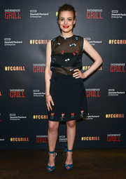 Gillian Jacobs styled her outfit with blue knot-detail peep-toe heels.
