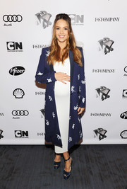 Jessica Alba looked refined in a navy floral coat by Carolina Herrera layered over a white maternity dress at the Fast Company Innovation Festival.