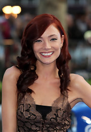 Clara Paget's ringlet curls looked totally lovely on the redheaded beauty.