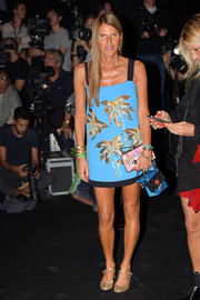 Anna dello Russo was tropical-chic in a beaded turquoise mini dress by Fausto Puglisi during the label's fashion show.