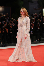 Emma Stone was boho-glam in an embroidered nude gown by Louis Vuitton at the Venice Film Festival screening of 'The Favourite.'