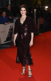 Rachel Weisz shimmered in a burgundy sequined dress with flutter sleeves and a fluted hem at the UK premiere of 'The Favourite.'