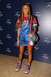 Anna dello Russo's shoulder bag added an extra dose of color and print to her look. Her dress, shoes, and bag are all Marc by Marc Jacobs.