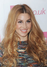 Whitney Port attended the Fearne Cotton Spring 2012 runway show with her long hair wavy and tousled. To recreate her look,  curl three-inch sections with a large-barreled curling iron.  Next, lightly comb through hair to soften curls, gently muss with fingertips and finish with a product like ALTERNA Caviar Anti-Aging Rapid Repair Spray for added shine.
