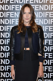 Ana Girardot mixed fabrics with a leather and denim fitted jacket at the Fendi runway show in Milan.