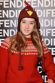 Leonetta Fendi topped off her funky look with a rooster earflap cap while attending the Fendi runway show.