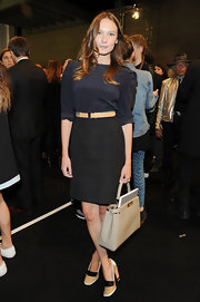 Ana Girardot's black pencil skirt was stylish and sophisticated at the Fendi runway show.