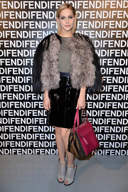 Leigh Lezark showed her edgy side with a shiny leather skirt and over-sized fur coat at the Fendi runway show.