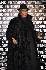 Andre Leon Talley showed off his signature long coat style with this black fur coat at the Fendi runway show.