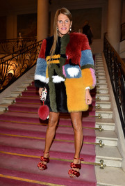 Anna dello Russo continued the flamboyance with a pair of chunky red braided sandals.