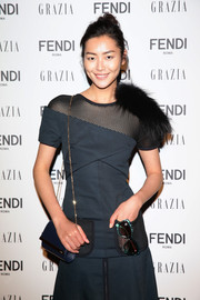 Liu Wen paired a blue chain-strap bag with a mesh-panel dress for the Fendi party.