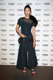 Liu Wen was modern and edgy in a dark teal mesh-panel maxi dress during the Fendi party.