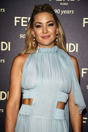 Kate Hudson sported a center-parted half-up style at the Fendi Roma 90th anniversary cocktail.
