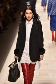 Bella Hadid showed off a stylish black top-handle tote on the Fendi runway.