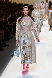 Bella Hadid walked the Fendi runway looking ultra girly in a print blouse with scalloped sleeves.