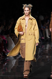 Bella Hadid looked cool in a camel-colored duster coat layered over a baggy jumpsuit at the Fendi Spring 2020 runway show.