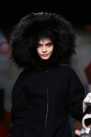 Cara Delevinge bundled up on the Fendi runway.