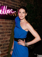 She is supporting this event by accessorizing her electric blue Acne dress with bangles by the host.