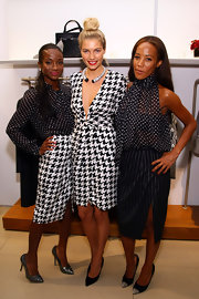 Genevieve Jones looked sophisticated in gunmetal gray glitter pumps at Ferragamo's Black and White Fete.
