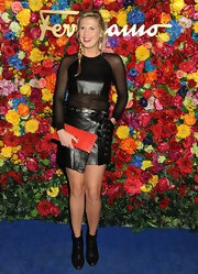 Alexandra Richards topped off her punk-inspired look with this leather wrap mini skirt.