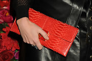 Alexandra Richards added some color to her black leather look with this oversized leather clutch in a vibrant crimson hue.