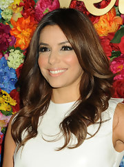 A nude lip color gave Eva Longoria a soft and glowing beauty look!