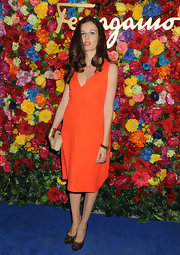 Chiara Clemente rocked this bold tangerine frock at the NYC launch of Ferragamo's L'Icona Highlighting.