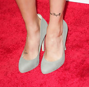 Katie has three stars inked on the top of her right foot.